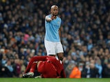 Vincent Kompany takes down Mo Salah during the Premier League game between Manchester City and Liverpool on January 3, 2019