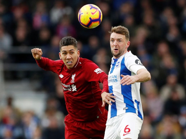 Liverpool's Roberto Firmino and Brighton & Hove Albion's Dale Stephens challenge for the ball on January 12, 2019.