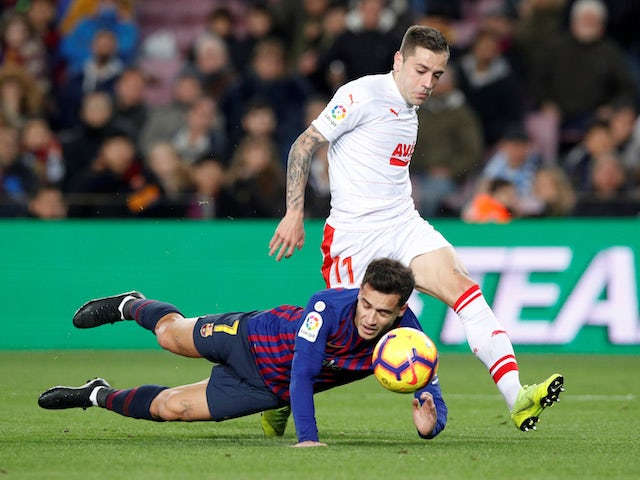Barcelona's Philippe Coutinho in action with Eibar's Ruben Pena on January 13, 2019.