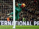 Manchester United goalkeeper David de Gea saves a shot during his side's Premier League clash with Tottenham Hotspur on January 13, 2019