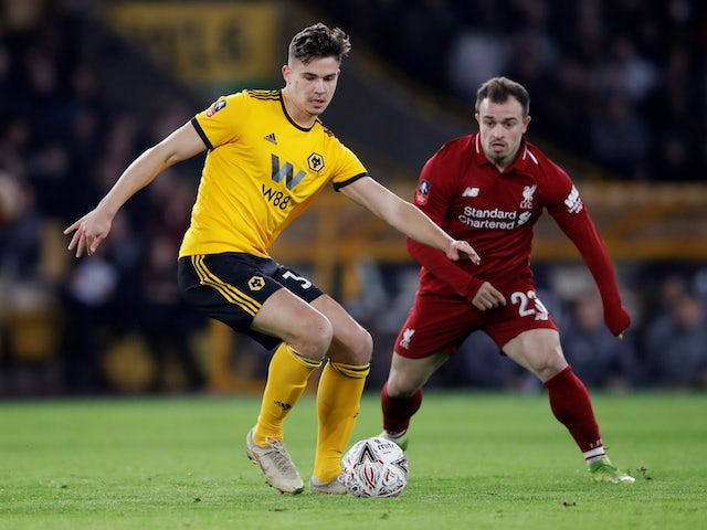 Leander Dendoncker and Xherdan Shaqiri in action during the FA Cup third-round game between Wolverhampton Wanderers and Liverpool on January 7, 2019