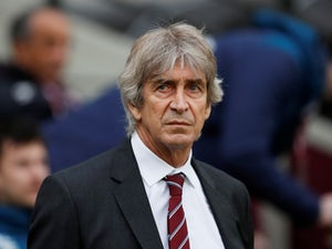 West Ham United manager Manuel Pellegrini watches on during his side's Premier League clash with Arsenal on January 12, 2019