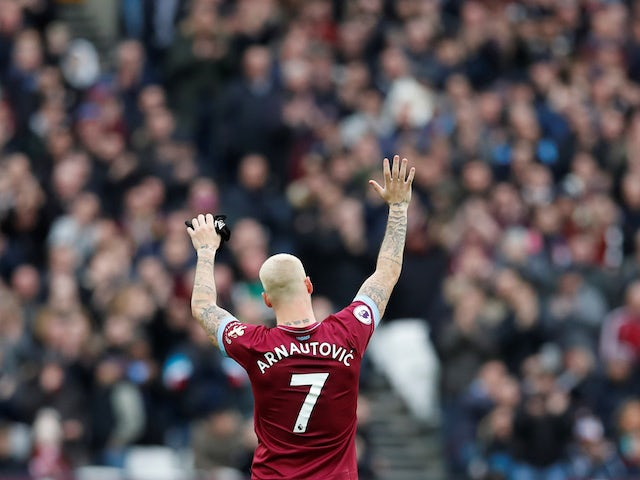 West Ham forward Marko Arnautovic waves goodbye during his side's Premier League clash with Arsenal on January 12, 2019