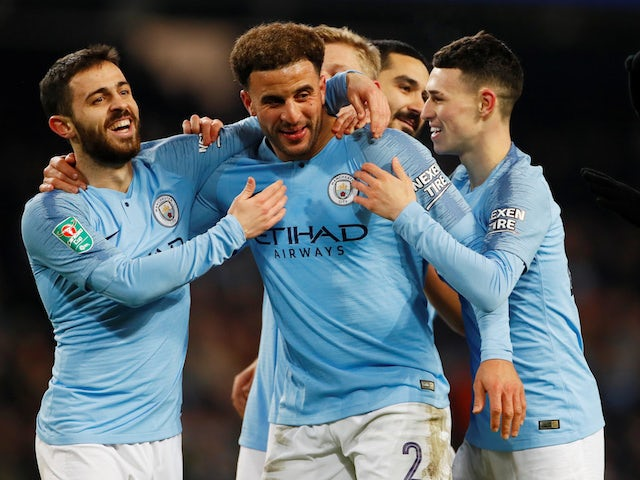 Manchester City defender Kyle Walker celebrates with teammates after scoring in the EFL Cup semi-final against Burton Albion on January 9, 2019