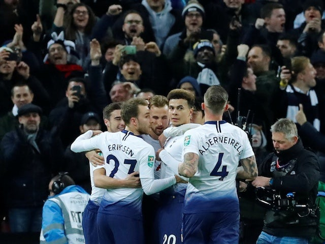 Tottenham Hotspur striker Harry Kane celebrates with teammates after opening the scoring against Chelsea in their EFL Cup semi-final on January 8, 2019