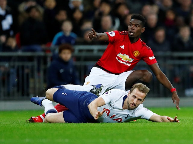 Manchester United midfielder Paul Pogba challenges Tottenham Hotspur striker Harry Kane during their Premier League clash on January 13, 2019