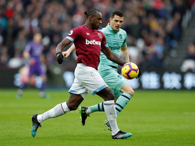 West Ham United's Michail Antonio is chased by Arsenal's Granit Xhaka during their Premier League clash on January 12, 2019