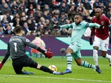 West Ham goalkeeper Lukasz Fabianski thwarts Arsenal striker Alexandre Lacazette during their Premier League clash on January 12, 2019