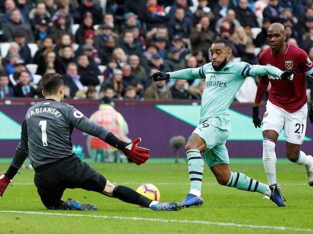 West Ham goalkeeper Lukasz Fabianski thwarts Arsenal striker Alexandre Lacazette during their Premier League clash on January 12, 2019