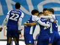 Wigan Athletic's Gary Roberts celebrates scoring their first goal with team mates against Aston Villa on January 12, 2018