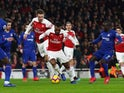 Arsenal's Alexandre Lacazette dribbles with the ball against Chelsea in the Premier League on January 19, 2019.