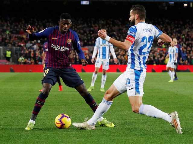 Barcelona's Ousmane Dembele in action with Leganes' Dimitris Siovas in La Liga on January 20, 2019.