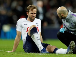 Spurs frontman Harry Kane sits injured on January 13, 2019