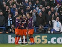 Manchester City players celebrate during their Premier League clash with Huddersfield Town on January 20, 2019