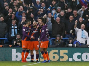 Man City ease past managerless Huddersfield