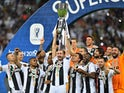 Juventus players celebrate winning the Italian Super Cup against AC Milan on January 16, 2019