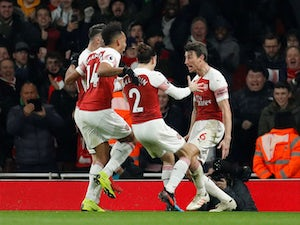 Laurent Koscielny celebrates scoring Arsenal's second goal against Chelsea in the Premier League on January 19, 2019.