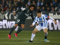 Real Madrid's Marcelo in action with Leganes' Unai Bustinza in the Copa del Rey on January 16, 2019.