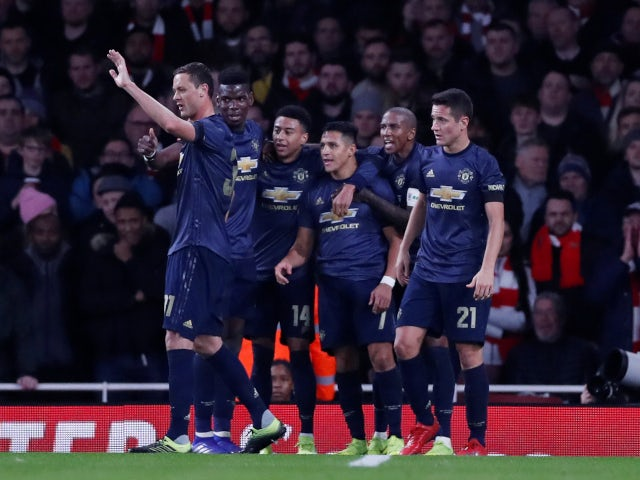 Alexis Sanchez is congratulated by his Manchester United teammates after opening the scoring against Arsenal on January 25, 2019