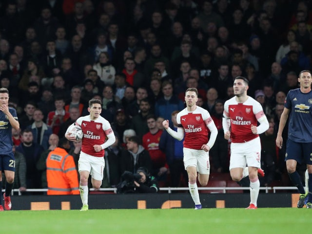 Arsenal's players react to Pierre-Emerick Aubameyang's goal against Manchester United on January 25, 2019