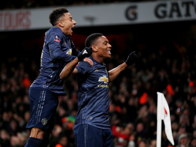 Anthony Martial and Jesse Lingard celebrate Manchester United's third goal against Arsenal on January 25, 2019