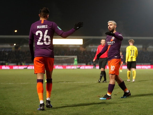 Manchester City striker Sergio Aguero celebrates with Riyad Mahrez after scoring against Burton Albion in their EFL Cup semi-final second leg on January 23, 2019