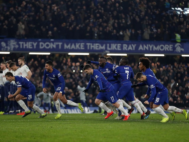 Chelsea players celebrate their penalty shootout win against Tottenham Hotspur in the EFL Cup on January 24, 2019
