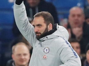 New Chelsea signing Gonzalo Higuain waves to the crowd ahead of the EFL Cup semi-final against Tottenham Hotspur on January 24, 2019
