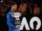 Novak Djokovic poses with the Australian Open trophy on January 27, 2019