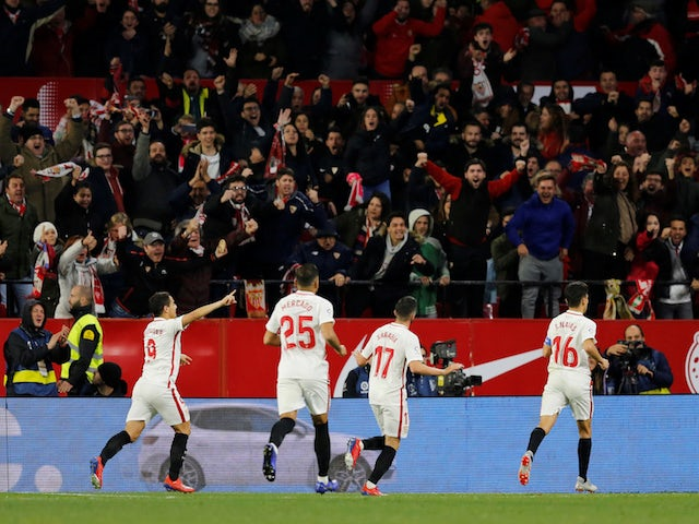Sevilla players celebrate scoring against Barcelona in the Copa del Rey on January 23, 2019.