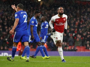 Arsenal improve to overcome Cardiff