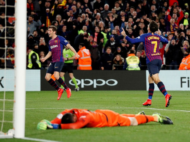 Barcelona's Philippe Coutinho celebrates after scoring his second against Sevilla on January 30, 2019
