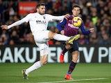 Barcelona's Philippe Coutinho tangles with Valencia's Cristiano Piccini in La Liga on February 2, 2019