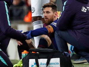 Barcelona's Lionel Messi receives attention on a dead leg on February 2, 2019