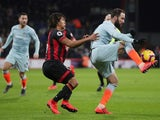 Chelsea's Gonzalo Higuain battles Bournemouth's Nathan Ake for the ball in the Premier League on January 30, 2019.