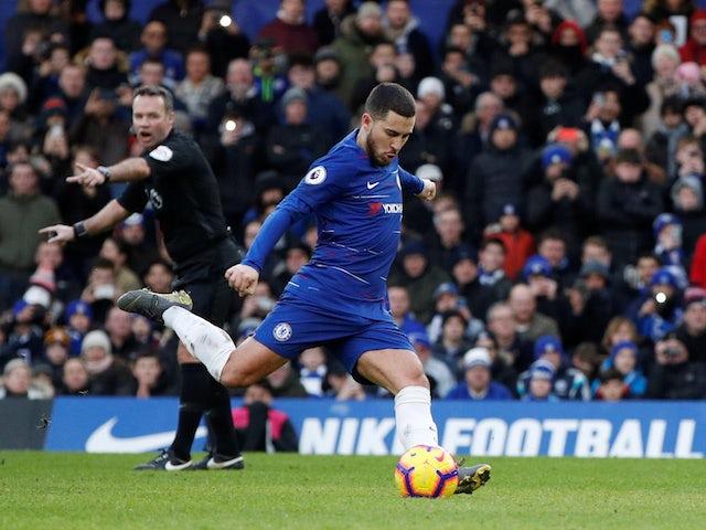 Chelsea's Eden Hazard scores a penalty against Huddersfield on February 2, 2019