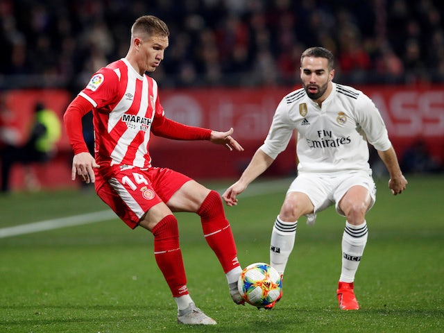 Real Madrid's Dani Carvajal in action with Girona's Raul Garcia in the Copa del Rey on January 31, 2019