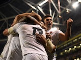 England players celebrate after scoring a try against Ireland in the Six Nations on February 2, 2019