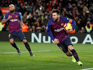 Barcelona attacker Lionel Messi grabs the ball after scoring against Valencia in La Liga on February 2, 2019