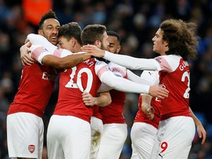 Arsenal's players celebrate after scoring against Manchester City in the Premier League on February 3, 2019