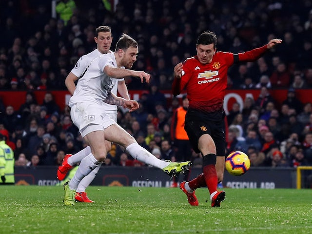 Burnley forward Ashley Barnes scores against Manchester United at Old Trafford on January 29, 2019.