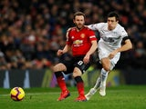 Manchester United midfielder Juan Mata tangles with Burnley midfielder Jack Cork at Old Trafford on January 29, 2019.