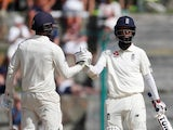 England's Moeen Ali celebrates a half-century with Ben Foakes against West Indies on January 31, 2019