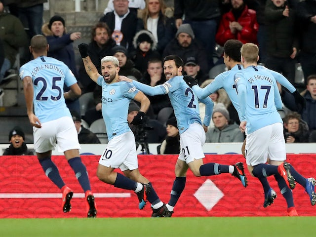 Manchester City striker Sergio Aguero celebrates with teammates after scoring against Newcastle United on January 29, 2019