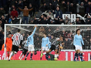 Newcastle stun Man City to dent title hopes