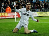 Ollie McBurnie celebrates scoring for Swansea City on January 29, 2019