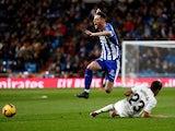 Alaves attacker Burgui jumps over Real Madrid's Sergio Reguilon in La Liga on February 3, 2019