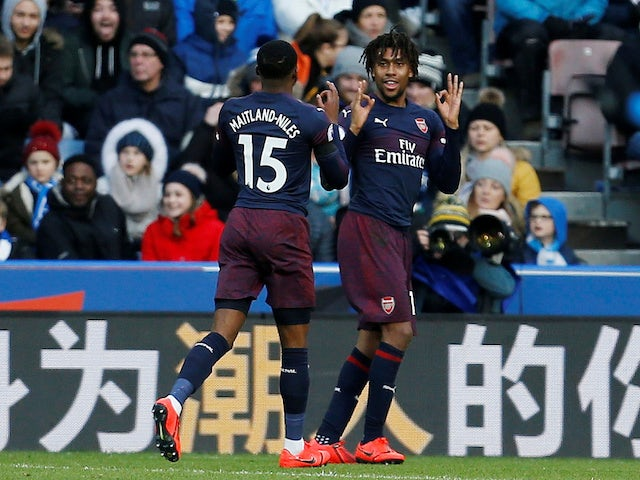 Arsenal's Alex Iwobi celebrates scoring the first goal against Huddersfield Town in the Premier League on February 9, 2019.