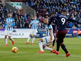 Alexandre Lacazette scores Arsenal's second goal against Huddersfield Town in the Premier League on February 9, 2019.