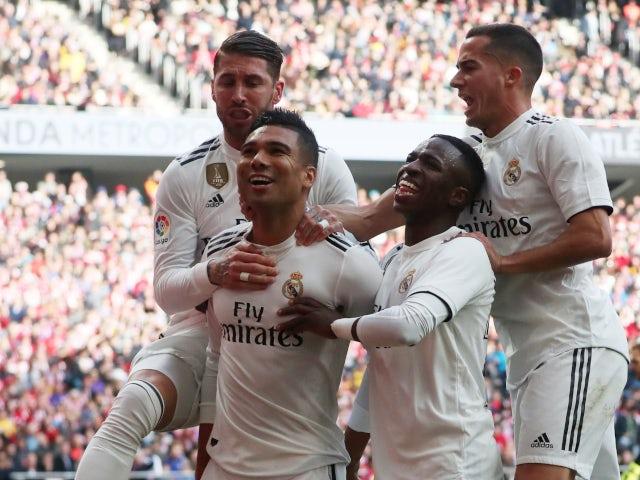 Real Madrid celebrate scoring against Atletico Madrid in La Liga on February 9, 2019.